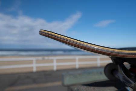 Close up of skateboard on top of a ramp at a beachside skate park. Banco de Imagens