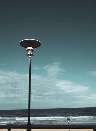Pair of streetlights at beachside location