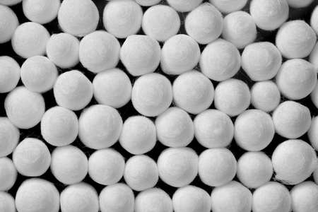 Close up image of a group of white cotton bud ends