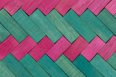 Vintage set of Pink and Green Cuisenaire rods in a diagonal pattern