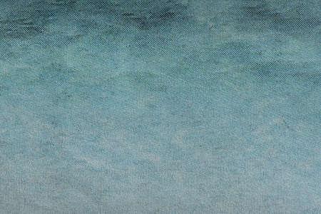 Macro image of a blue gradient CMYK dots on newsprint