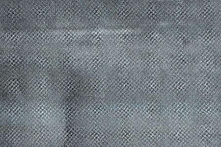Close up image of grey CMYK dots on newsprint