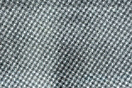 Macro image of grey CMYK dots on newsprint