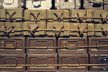 Close up of military supply cases stacked and tied on a truck