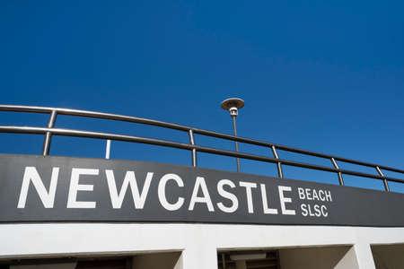 NEWCASTLE, AUSTRALIA - Jule 10  2019 Newcastle Beach Surf Lifesaving Club exterior against a clear blue sky