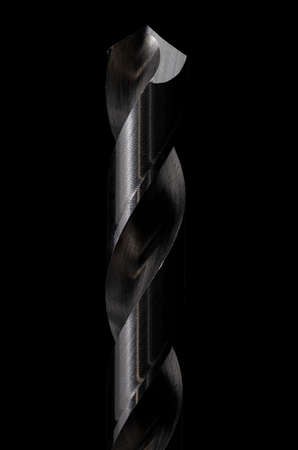 Macro image of a drill bit set against a black background Stock Photo