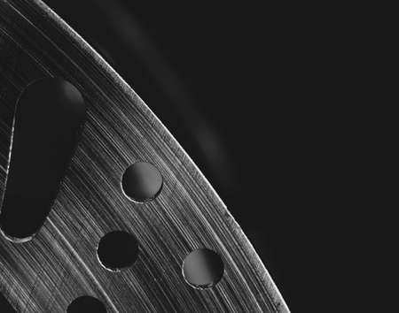 Macro image of a section of a mountain bike disc brake, set against a black background Stock Photo
