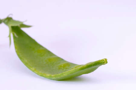 Close up image of a snow pea against a white background Stock Photo