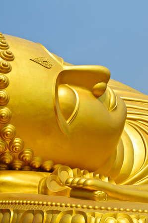 A golden  reclining buddha