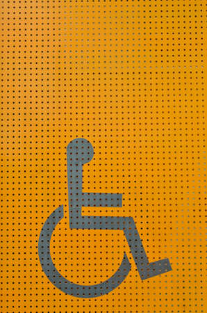 Disability sign on orange metal background Stock Photo - 15990995