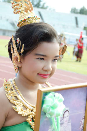 Thai girl in traditional dress during in a parade.Songkhla - July 20: unidentified students during Anuban Songkhla game parade  on July 20, Songkhla Thailand.