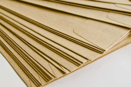 Pile of brown envelopes on white background  photo