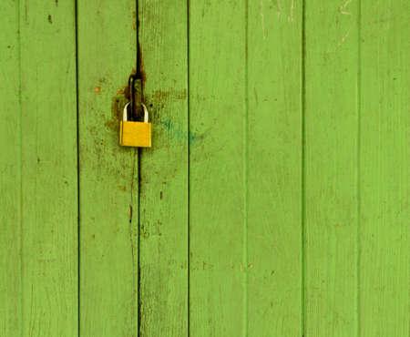 Old wood door with padlock Standard-Bild