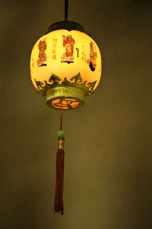 Hanging chinese lantern on the dark background photo