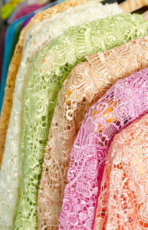 blouses: Sweet colored new lace blouses hanging in row on sale