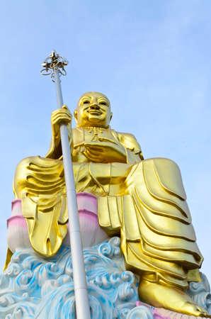 Big golden Bodhisattva statue with blue sky Stock Photo - 17314994