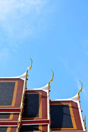 Temple roof against blue skyat wat po, Bangkok, Thailand photo
