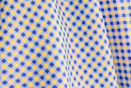 Blue and yellow gingham cloth background photo
