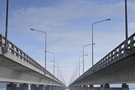 Long concrete bridge linking Koh Yor island and mainland, Tinsulanonda Bridges Thailand Stock Photo