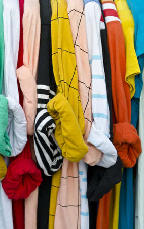 Colorful shirts on hangers photo