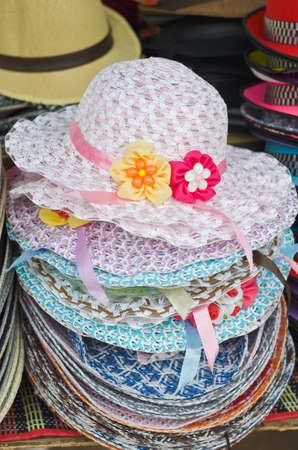 coif: Pile of decorated straw hats  ready to sell