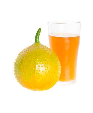 Gac fruit juice on white background