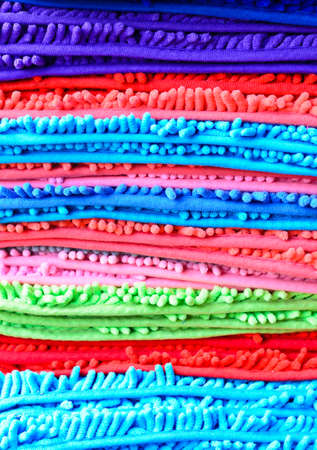 Colorful stack of bath mats photo