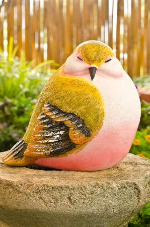 Bird statue in garden Stock Photo