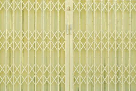 Yellow metal grille sliding door photo