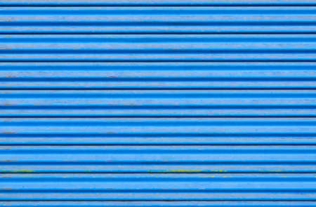 Grungy corrugated metal sheet slide door Stock Photo