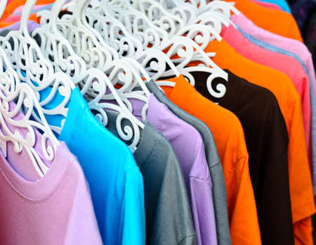 Colorful t-shirt on hangers Stock Photo