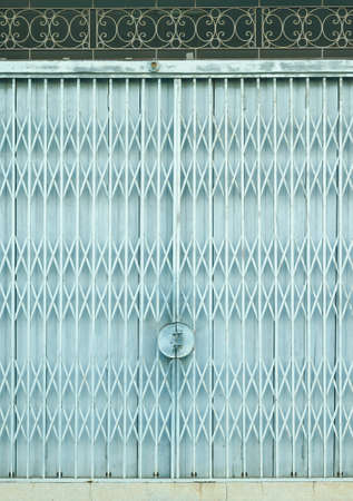 grille: Light blue old metal grille sliding door Stock Photo
