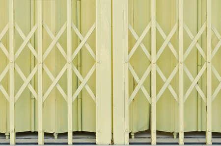Yellow metal grille sliding door