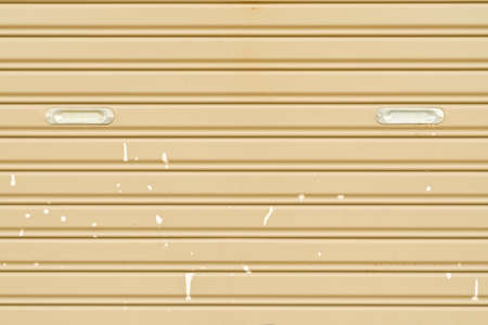 rolling garage door: Dirty corrugated metal sheet slide door