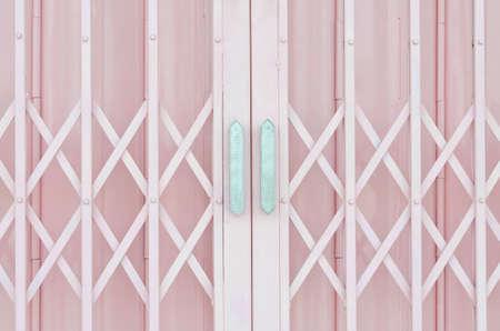 Pink metal grille sliding door with aluminium handle 版權商用圖片