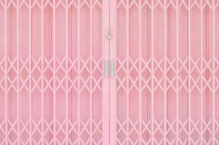 pad lock: Pink metal grille sliding door with pad lock and aluminium handle Stock Photo