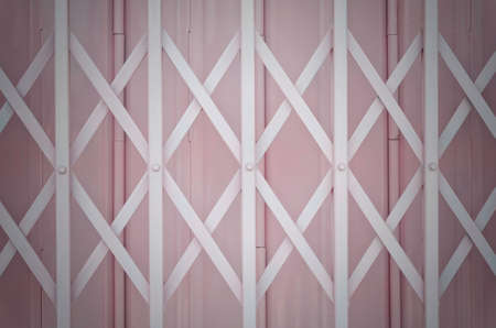 Pink metal grille sliding door with aluminium handle 版權商用圖片