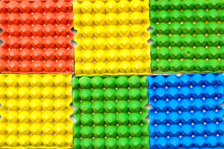 Colorful background from egg trays photo