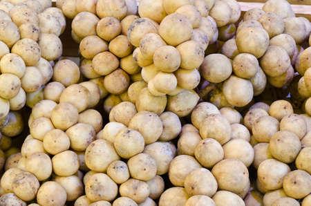 Longkong or Lanzones fruit in market photo