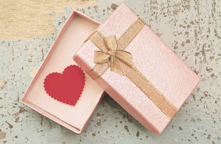 Red Heart In Gift Box On Grunge Wood Background Vintage Style Photo