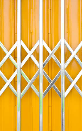 grille: Yellow metal grille sliding door