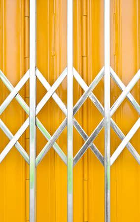 grille: Yellow metal grille sliding door