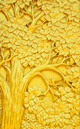 wood carvings: Traditional Thai style art golden tree carving on temple door Stock Photo