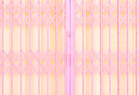 Yellow and pink metal sliding grille door
