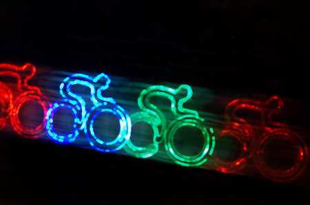 design abstract: colorful cyclist shape bokeh lights