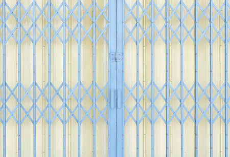 sliding: Yellow and grey metal grille sliding door Stock Photo