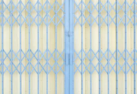 Yellow and grey metal grille sliding door 版權商用圖片