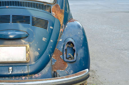 abandoned car: Old abandoned blue rusty car Stock Photo