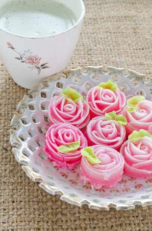 gulab: Rose flower sweet (ALUA GULAB )Thai dessert  with cup of milk green tea Stock Photo