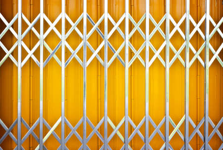 Yellow metal grille sliding door